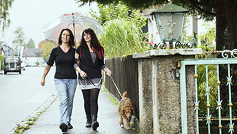 consumer with ostomy walking dog