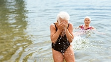 woman bathing with an ostomy